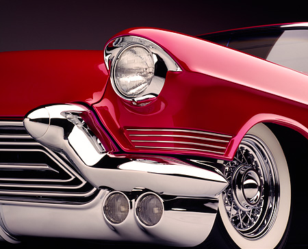 AUT 30 RK0066 02 © Kimball Stock Close Up Of 1957 Candy Raspberry Cadillac Eldorado Kustom Low Front View Of Headlights Grill And Tire