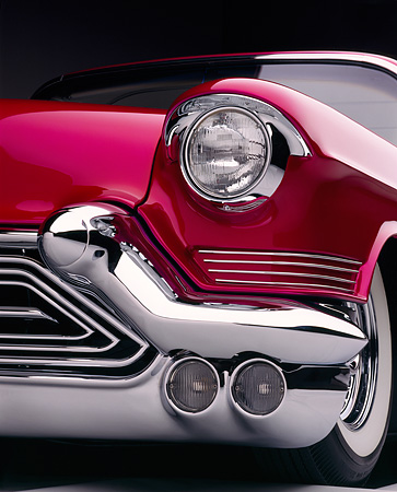 AUT 30 RK0067 06 © Kimball Stock Close Up Of 1957 Candy Raspberry Cadillac Eldorado Low Front Corner Of Headlight And Grill