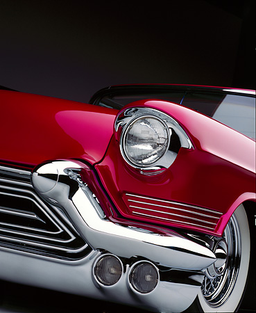 AUT 30 RK0067 14 © Kimball Stock Close Up Of 1957 Candy Raspberry Cadillac Eldorado Low Front Corner Of Headlight And Grill