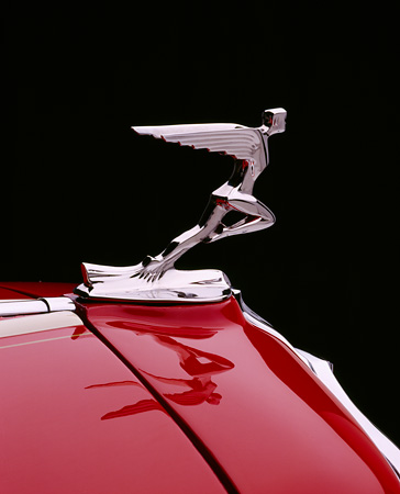 AUT 30 RK0083 03 © Kimball Stock Close Up Of An Auburn Cabriolet Hood Ornament Studio Background