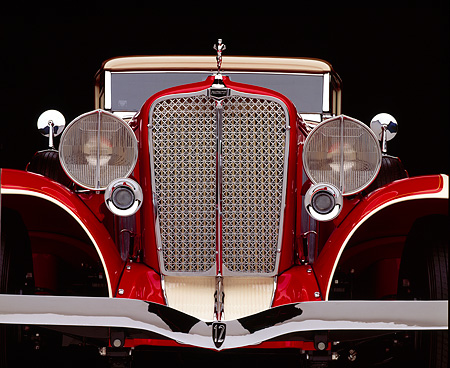 AUT 30 RK0084 03 © Kimball Stock Close Up Low Shot Of A 1932 Auburn Cabriolet Head On Grill And Headlights Studio