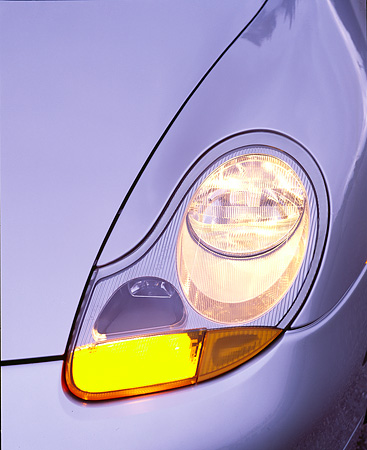 AUT 30 RK0100 03 © Kimball Stock 1999 Porsche 911 Carrera Headlight Detail Lights On