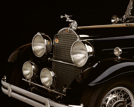 AUT 30 RK0115 02 © Kimball Stock 1930 Black Packard 850 Roadster Detail Front Hood And Emblem Studio Background