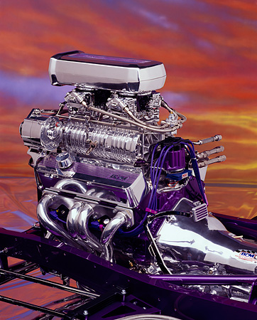 AUT 30 RK0192 05 © Kimball Stock Detail of Chevy Engine with sunset background.