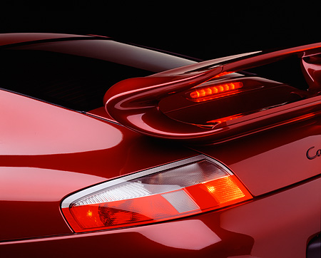 AUT 30 RK0218 05 © Kimball Stock 1999 Porsche 996 Arena Red Detail Rear Light And Spoiler Brake Lights On Studio