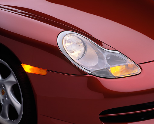 AUT 30 RK0221 02 © Kimball Stock 1999 Porsche 996 Arena Red Headlight Detail