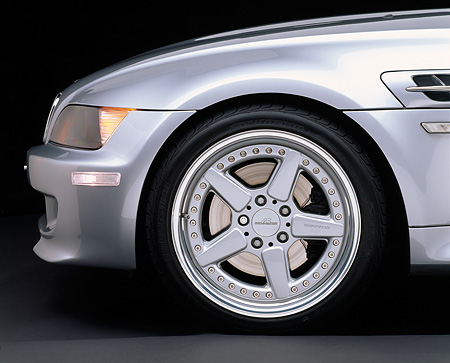 AUT 30 RK0248 05 © Kimball Stock 1999 BMW M Roadster Silver Detail Of Front Wheel Parking Lights On