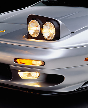 AUT 30 RK0261 02 © Kimball Stock 1999 Lotus Esprit V8 Silver Detail Of Front Headlight