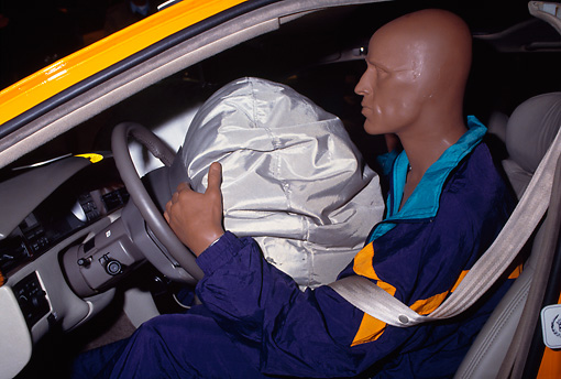 AUT 30 RK0275 03 © Kimball Stock Crash Dummy In Car With Air Bag