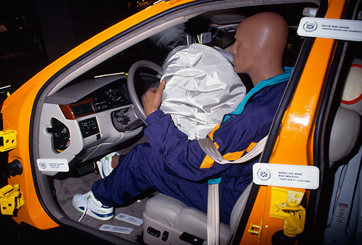 AUT 30 RK0275 08 © Kimball Stock Crash Dummy In Car With Air Bag