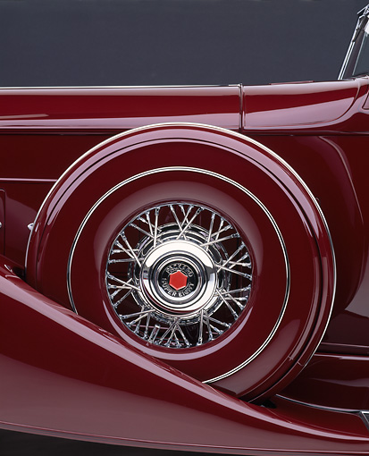 AUT 30 RK0297 07 © Kimball Stock 1933 Packard Convertible  Burgundy Detail Shot Of Covered Spare Wheel  Studio