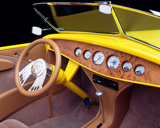 AUT 30 RK0390 15 © Kimball Stock 1932 Ford Hi-Boy Convertible Yellow With Flames Detail Interior Front Dash