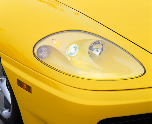 AUT 30 RK0402 02 © Kimball Stock 1999 Ferrari 360 Modena Yellow Headlight Detail