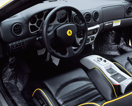 AUT 30 RK0404 02 © Kimball Stock 1999 Ferrari 360 Modena Yellow Detail Dashboard Steering Wheel