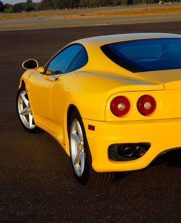 AUT 30 RK0407 02 © Kimball Stock 1999 Ferrari 360 Modena Yellow Rear Side Shot On Pavement