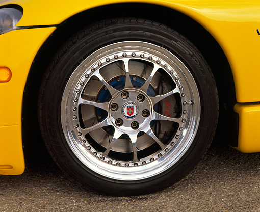 AUT 30 RK0434 05 © Kimball Stock 1996 Hennessey Viper Venom 650R Yellow Front Wheel Detail