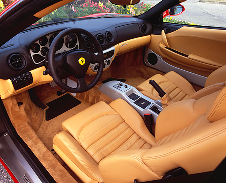 AUT 30 RK0463 03 © Kimball Stock 1999 Ferrari 360 Modena Red Detail Interior Front Seats Steering Wheel And Dash