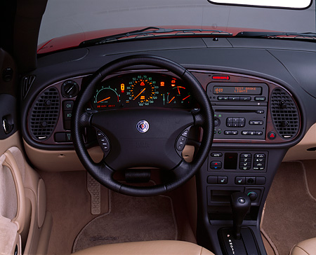 AUT 30 RK0664 02 © Kimball Stock 2001 Saab 9-3 Convertible Red Detail Front Dash And Steering Wheel