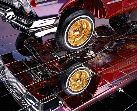 AUT 30 RK0840 01 © Kimball Stock 1963 Chevy Impala Lowrider Detail Parts And Graphics Under Car