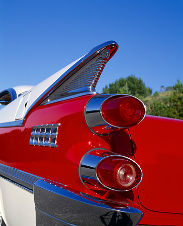 AUT 30 RK0844 01 © Kimball Stock 1959 Dodge Royal Hardtop Red And White Detail Rear Fin Shot Blue Sky
