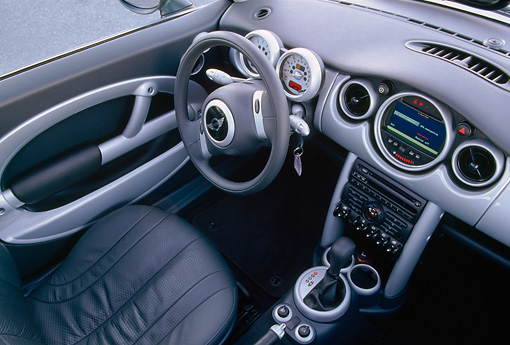 AUT 30 RK0910 03 © Kimball Stock 2002 BMW Mini Cooper Silver Detail Interior Shot Steering Wheel Front Dash