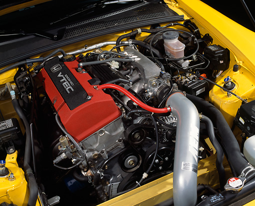 AUT 30 RK1004 01 © Kimball Stock 2001 Honda S2000 Convertible Yellow Detail Engine Shot