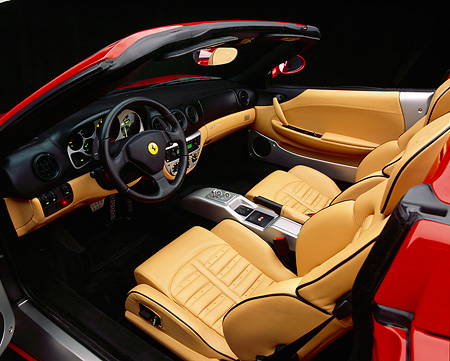AUT 30 RK1717 02 © Kimball Stock 2002 Ferrari 360 Modena F1 Spyder Red Detail Interior Shot Front Dash Steering Wheel Leather Seats