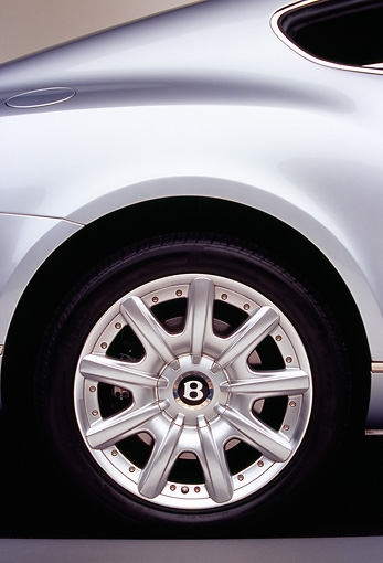 AUT 30 RK1804 02 © Kimball Stock 2004 Bentley Continental GT Silver Detail Rear Side Tire Shot