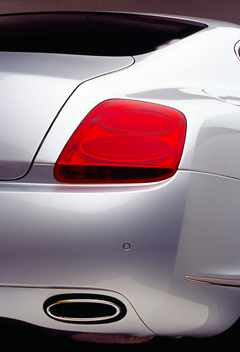 AUT 30 RK1806 02 © Kimball Stock 2004 Bentley Continental GT Silver Detail Close Up Rear Brake Light And Exhaust