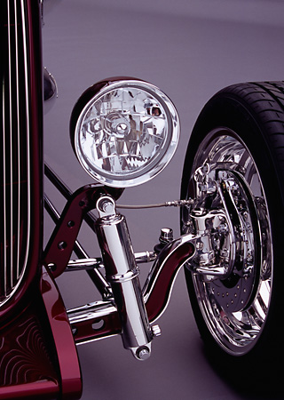 AUT 30 RK1877 03 © Kimball Stock 1932 Ford Custom Roadster Burgundy Headlight And Suspension Detail