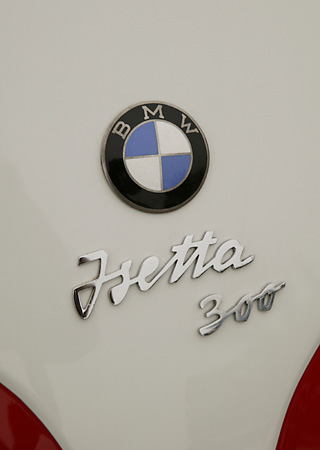AUT 30 RK1955 01 © Kimball Stock 1958 BMW Isetta Red And White Detail Emblem