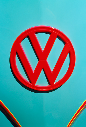 AUT 30 RK2060 01 © Kimball Stock 1957 Volkswagen Bus Emblem Red On Light Blue Body Panel Head On View