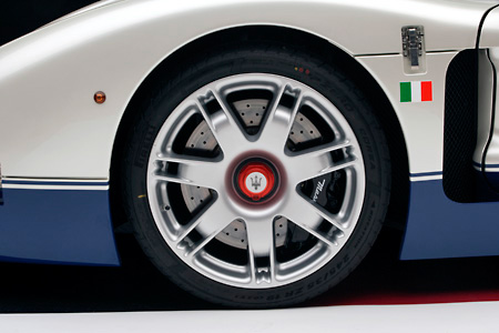AUT 30 RK2445 01 © Kimball Stock 2005 Maserati MC12 White And Blue Detail Front Tire And Rim