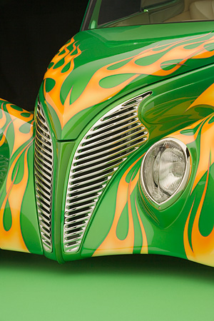 AUT 30 RK2938 01 © Kimball Stock 1939 Ford Sedan Green With Flames Detail Front Hood Grill And Headlight