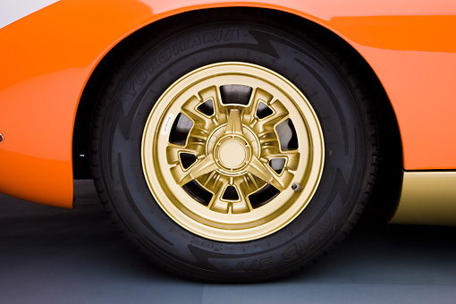 AUT 30 RK4177 01 © Kimball Stock 1972 Lamborghini Miura Orange Front Wheel Detail Studio