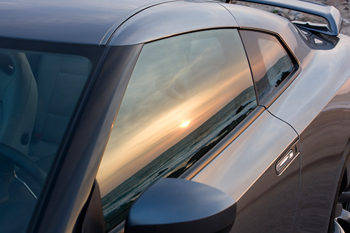 AUT 30 RK4212 01 © Kimball Stock 2009 Nissan GT-R Gray Window Detail At Sunset