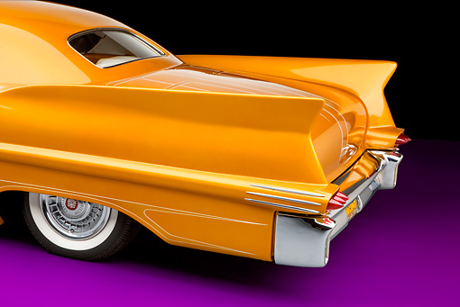 AUT 30 RK4404 01 © Kimball Stock 1957 Cadillac Coupe De Ville Gold 1/4 Panel Detail Rear View Studio