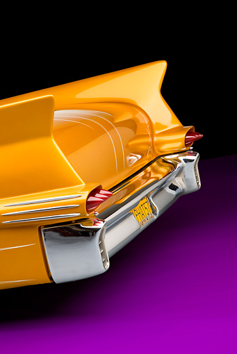 AUT 30 RK4406 01 © Kimball Stock 1957 Cadillac Coupe De Ville Gold Tailfin Detail Rear View Studio