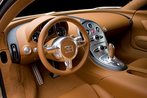 AUT 30 RK4418 01 © Kimball Stock 2008 Bugatti Veyron 16.4 Grand Sport Roadster Gold And White Interior Detail Studio