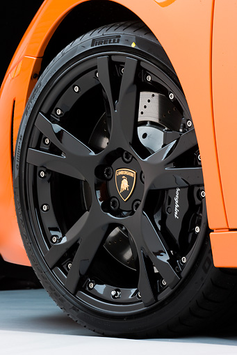 AUT 30 RK4520 01 © Kimball Stock 2009 Lamborghini Gallardo LP560-4 Orange Front Wheel Detail Studio