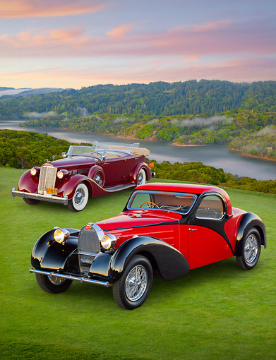 AUT 31 RK0115 01 © Kimball Stock 1937 Bugatti Type 57 S Atalante Coupe Red And Black And 1936 Packard Super 8 Dual Cowl Phaeton Maroon 3/4 Front View On Grass At Dusk