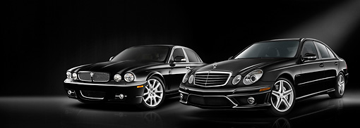 AUT 31 IZ0001 01 © Kimball Stock 2008 Jaguar XJ8 And 2009 Mercedes-Benz E63 Black 3/4 Front View Studio