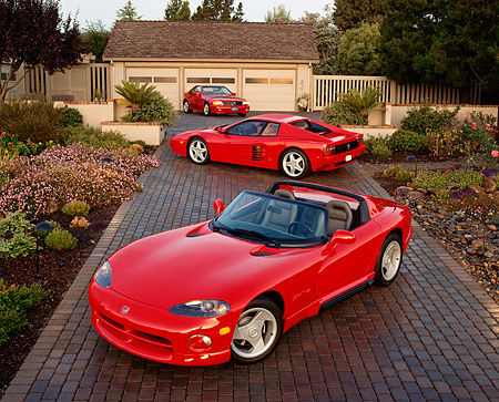 AUT 31 RK0010 15 © Kimball Stock 1992 Red Ferrari And Viper 1994 Red Mercedes At 3/4 Angles On Driveway