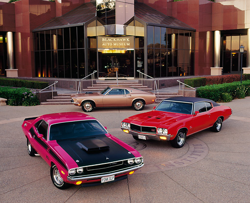 AUT 31 RK0012 02 © Kimball Stock 1970 Dodge Challenger And Buick, 1969 Ford Mustang, In Front Of Museum
