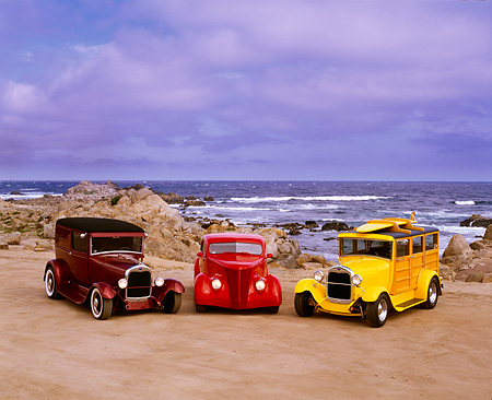 AUT 31 RK0013 02 © Kimball Stock 1929 Ford Woody and Sedan Delivery 1937 3-Window Coupe On Sand At Beach