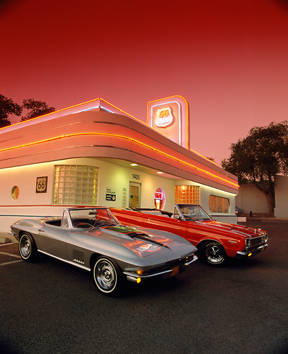 AUT 31 RK0016 01 © Kimball Stock 1967 Corvette 427 And 1967 Plymouth Belvedere GTX 426 Hemi In Front Of Diner Red Sky