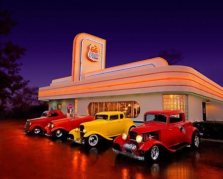 AUT 31 RK0017 27 © Kimball Stock 1935 Ford Coupe Red 1932 Ford Roadster Peach 1932 Ford Coupe Yellow 1932 Ford Coupe Razberry In Front Of Diner Route 66