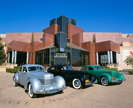 AUT 31 RK0043 01 © Kimball Stock Group Shot Of 1936 Cord 810 Westchester Sedans In Front Of Museum
