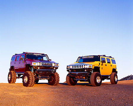 AUT 31 RK0044 05 © Kimball Stock Two 2003 Hummer H2s Yellow And Burgundy On Gravel