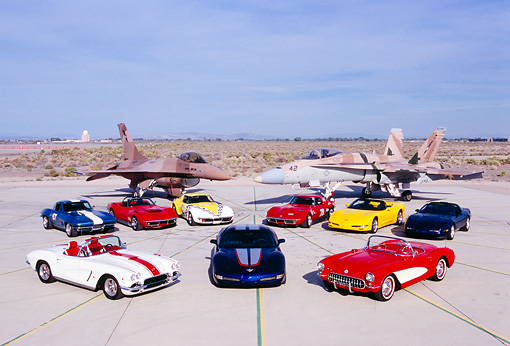 AUT 31 RK0053 07 © Kimball Stock Chevrolet Corvettes With Two Jet Fighters Blue Sky